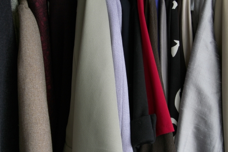 Clothes hanging in a closet  Stock Photo