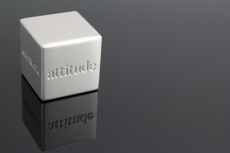 Metallic cube paperweight with the word  attitude  engraved in the side  Stock Photo - 14518730