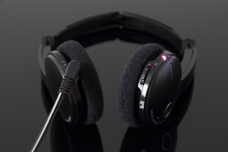 Rechargeable stereo bluetooth headphones with charging light on.
