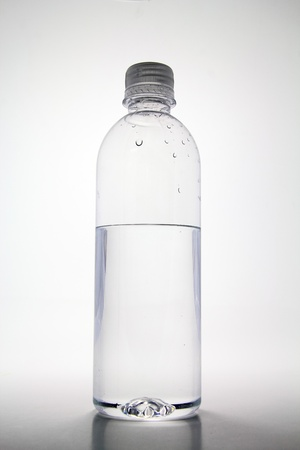Half empty plastic bottle of water.