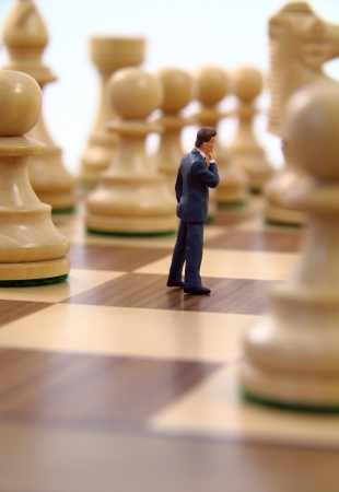 business game: Business character contemplating strategy.