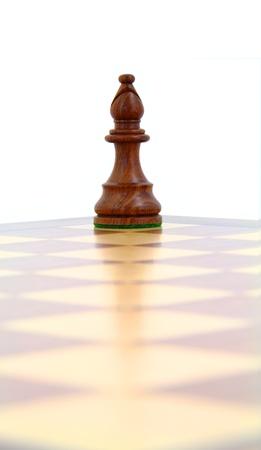 diagonal: Wooden chess bishop on a diagonal line