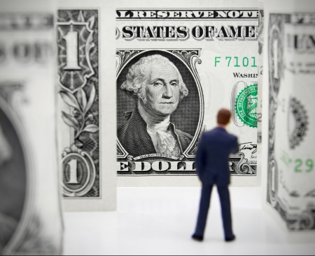 us currency: Vignette effect - Character contemplating which direction to take in a financial maze