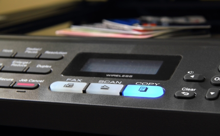 Credit cards and personal identification on a copier. photo