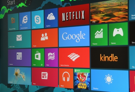 microsoft: Close up, angled shot of the new Windows 8 start screen on a desktop computer.
