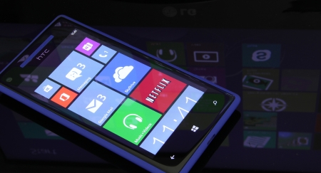 Windows phone 8 with Windows 8 in the reflection. Editorial