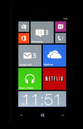 microsoft: Windows Phone 8 screen tiles isolated on black.