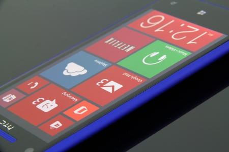 htc: Close up of a blue, HTC 8x Windows Phone 8. Editorial