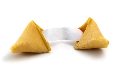 fortune cookie: Broken fortune cookie with an exposed, blank fortune paper strip.