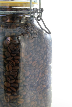 Close up of a glass jar of coffee beans