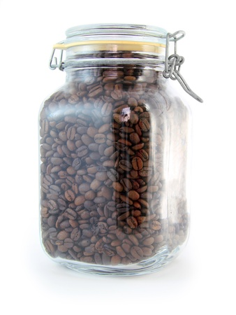 Large glass jar full of coffee beans  Imagens