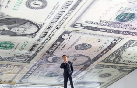in ceiling: Political figure standing under a ceiling made of US money