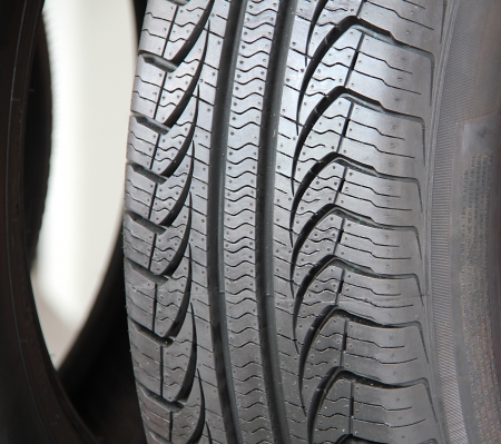 tire tread: Picture of a care tire tread at an angle.