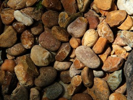 Bovenaanzicht van een groep ronde stenen.