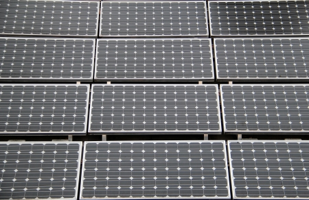 Rectangular solar panels on a roof top.