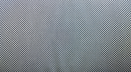 checker: Close-up of black and white checker fabric texture.
