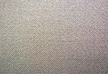 knotting: Close-up picture of the fabric on a tan colored office chair.