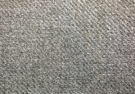 Close-up picture of the fabric on an chair. Imagens