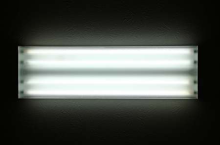 Horizontal shot of ceiling bar fluorescent lights.