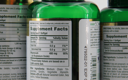 View of supplement facts on the back of vitamin bottles.