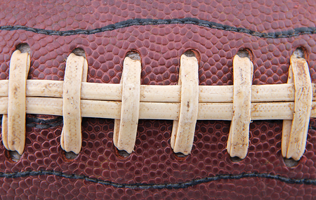 Closeup of the laces on a football.