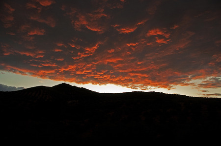 clouded: Clouded sunset over the mountains in Granada, Spain Stock Photo