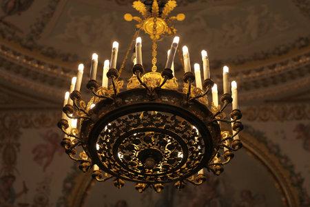 candelabrum: Bronze chandelier. Antiques palace interiors