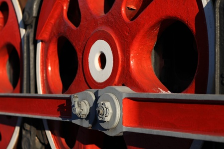 The wheels of the old steam locomotive, a fragment, close-up photo