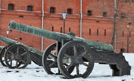 The old medieval bronze cannon on the gun carriage Stock Photo