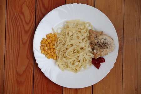 pasta with maize and chicken meat Stock Photo