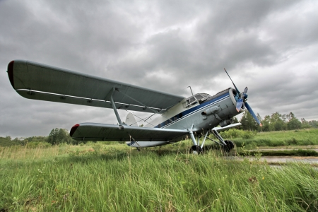 Biplane on the airfield side view photo