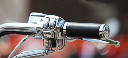 throttle: Steering wheel motorcycle throttle control lever close up