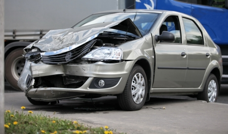 Frustrated after a collision with a truck Renault Logan car is a side view Stock Photo