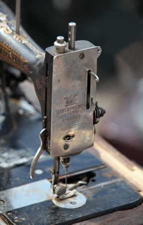 Old hand sewing machine details and close-up photo