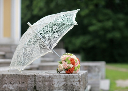 Summer lace parasol and a bouquet of bright colors