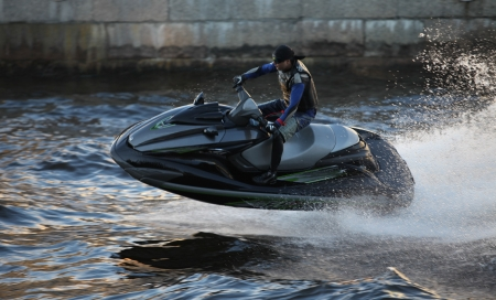 The seadoo  at high speed lifts a large wave