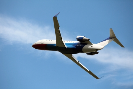 business jet in the blue sky Stock Photo - 14964801