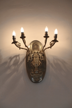Antique candlestick on the wall