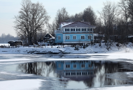 stoking: home on the bank of the Neva river the winter