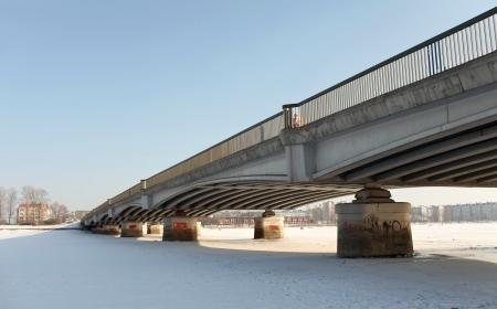 Bridge over frozen waters photo