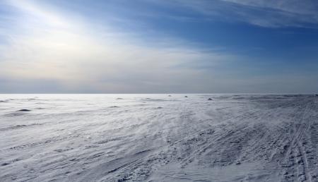 wind  frozen sea looking like white snowy desert
