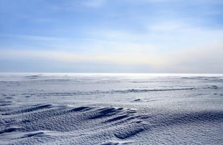 frozen sea looking like white snowy desert