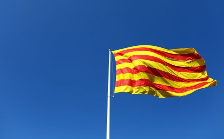 Catalan flag blowing in the wind Stock Photo