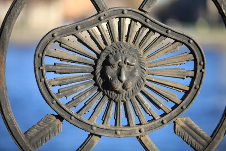 the old cast iron barelef lion head on a background of water close to  Stock Photo