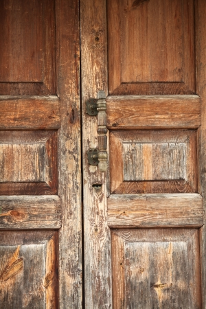 view of a wooden doorway: the Closed old entrance wooden door