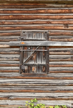 Boarded  up door of an old barn photo