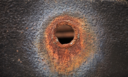 a bullet hole in the steel sheet