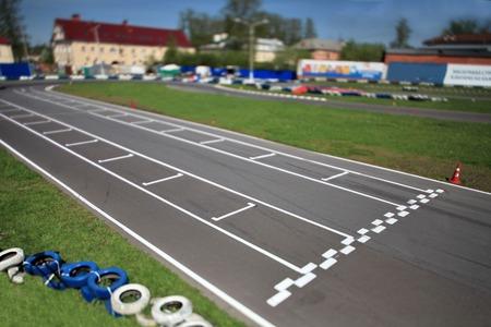 tilt: Karting  racing round the track Tilt Stock Photo
