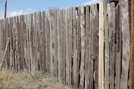 picket fence: unpainted old wooden Picket  fence