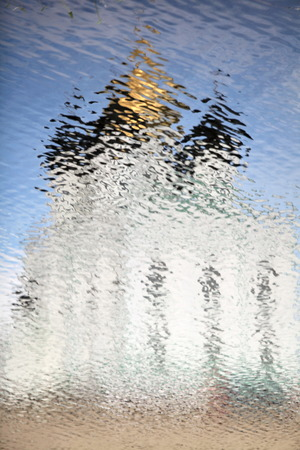 looming: looming Russian church reflection ripples Stock Photo